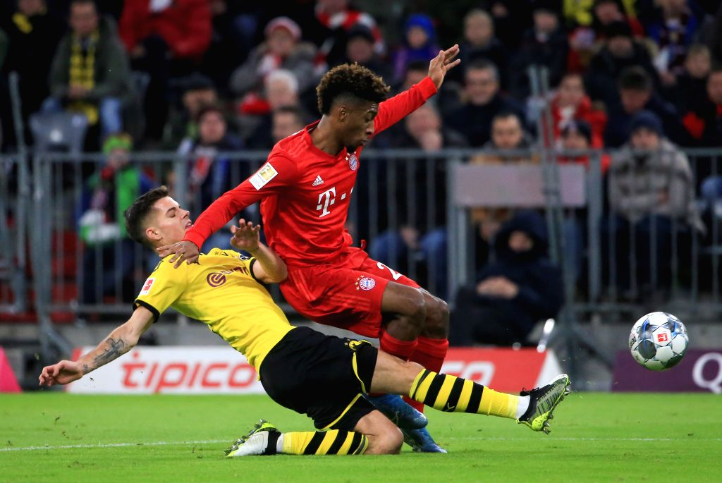 MUNICH, Nov. 10, 2019 (Xinhua) -- Kingsley Coman (top) of Bayern Munich vies with Julian Weigl of Dortmund during a German Bundesliga between FC Bayern Munich and Borussia Dortmund in Munich, Germany, on Nov. 9, 2019. (Photo by Philippe Ruiz/Xinhua/I
