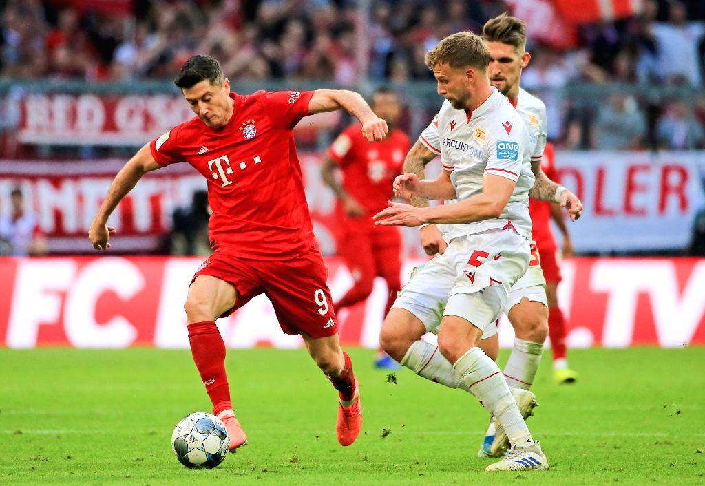 MUNICH, Oct. 27, 2019 - Robert Lewandowski (L) of Bayern Munich vies with Marvin Friedrich (C) of Union Berlin during a German Bundesliga match between FC Bayern Munich and 1.FC Union Berlin in ...
