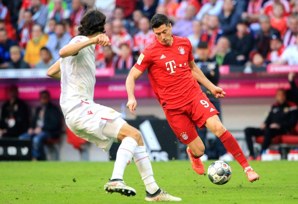 MUNICH, Oct. 27, 2019 - Robert Lewandowski (R) of Bayern Munich vies with Neven Subotic of Union Berlin during a German Bundesliga match between FC Bayern Munich and 1.FC Union Berlin in Munich, ...