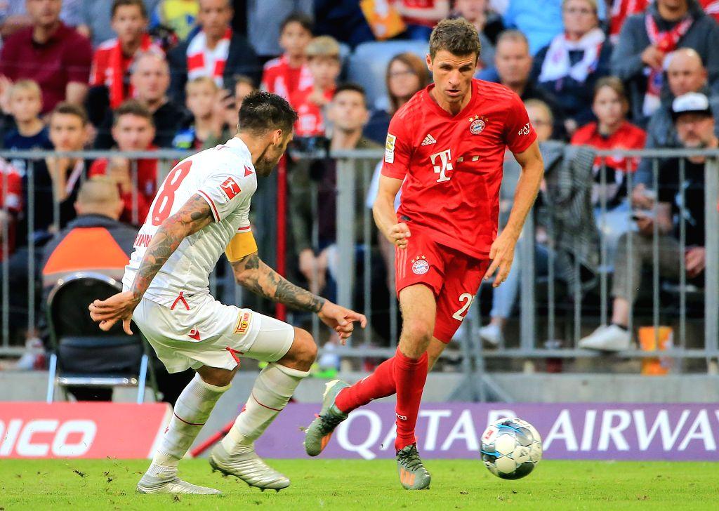 MUNICH, Oct. 27, 2019 - Thomas Mueller (R) of Bayern Munich vies with Christopher Trimmel of Union Berlin during a German Bundesliga match between FC Bayern Munich and 1.FC Union Berlin in Munich, ...