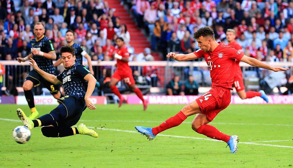 MUNICH, Sept. 22, 2019 - Ivan Perisic (R) of Bayern Munich takes a scoring shot during a German Bundesliga match between FC Bayern Munich and 1.FC Koeln in Munich, Germany, on Sept. 21, 2019.