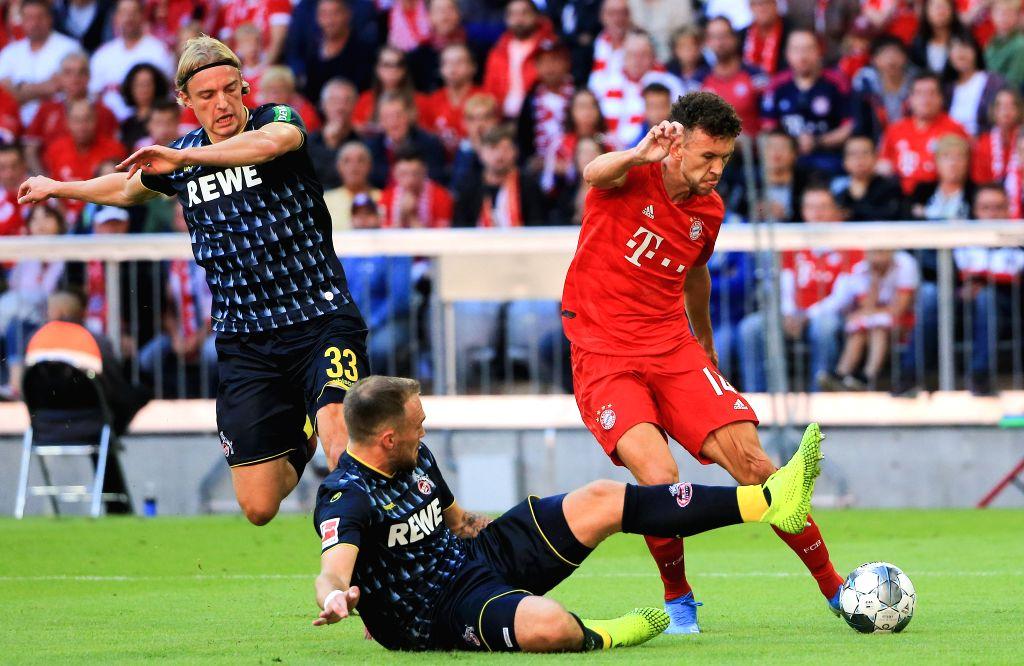 MUNICH, Sept. 22, 2019 - Ivan Perisic (R, top) of Bayern Munich vies with Rafael Czichos (bottom) of Koeln during a German Bundesliga match between FC Bayern Munich and 1.FC Koeln in Munich, Germany, ...