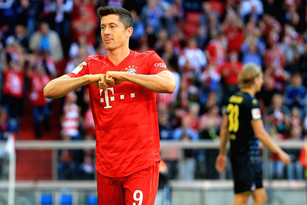 MUNICH, Sept. 22, 2019 - Robert Lewandowski (L) of Bayern Munich celebrates his second scoring during a German Bundesliga match between FC Bayern Munich and 1.FC Koeln in Munich, Germany, on Sept. ...