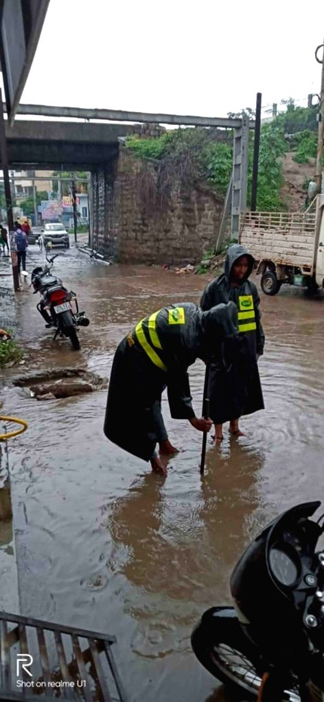 Municipal Corporation workers carry out de-silting after heavy rains leave Hyderabad streets water-logged street, on Sep 20, 2019.
