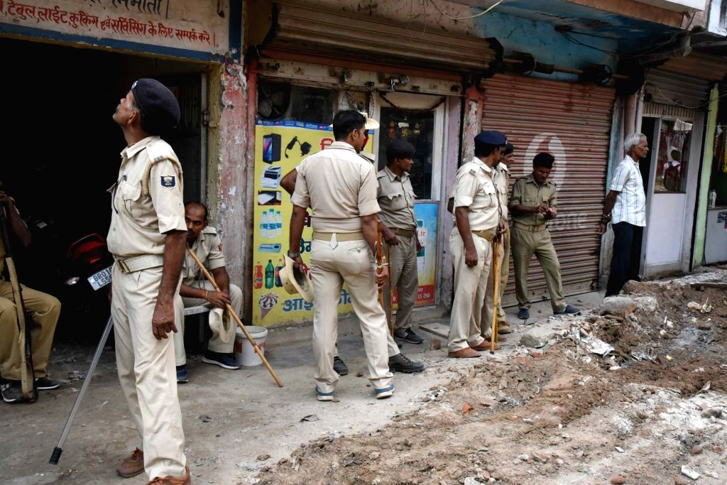Municipal workers carry out demolition drive of illegal structures in Patna on Oct 17, 2019.