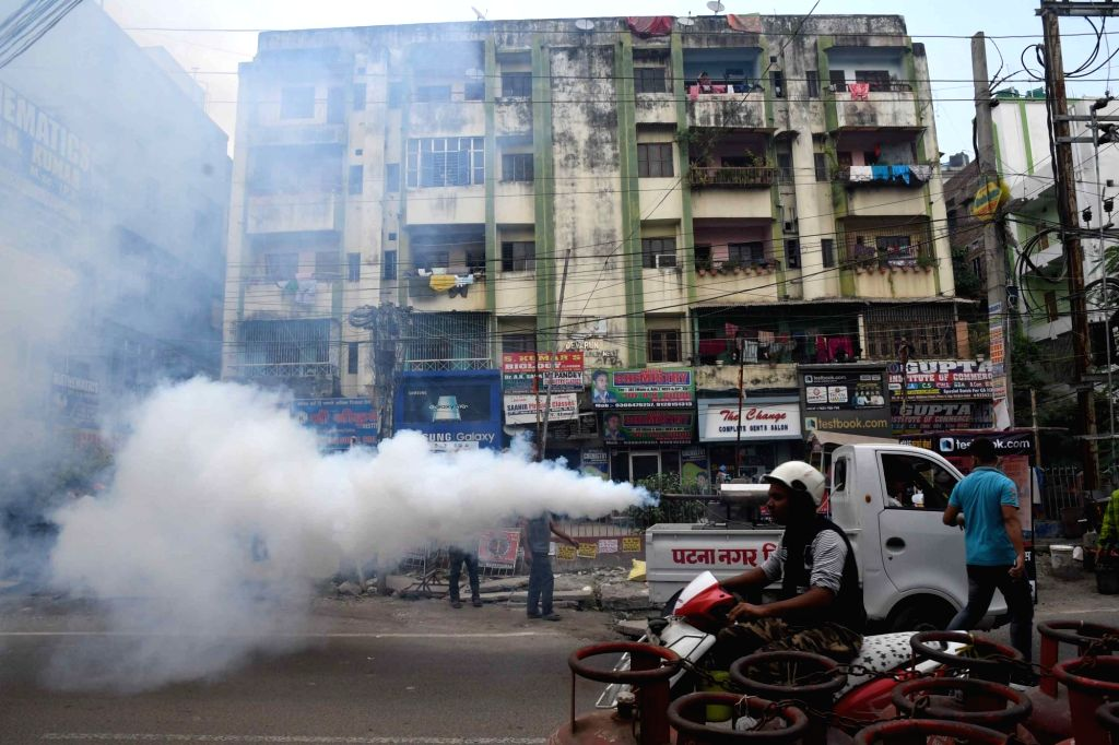 Municipal workers carry out fogging amidst fears of Dengue outbreak in Bihar; in Patna on Oct 17, 2019.