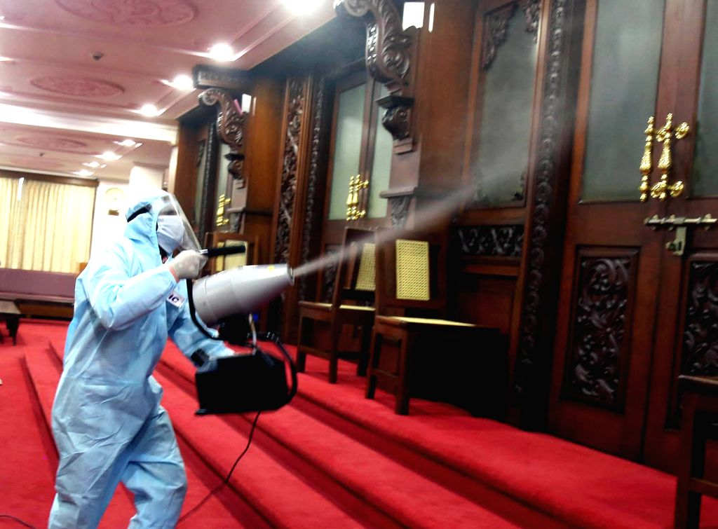 Municipal workers wearing PPE kits spray disinfectant around the Vidhana Soudha premises, after a policeman on duty tested Covid positive, in Bengaluru on July 6, 2020. The iconic ...