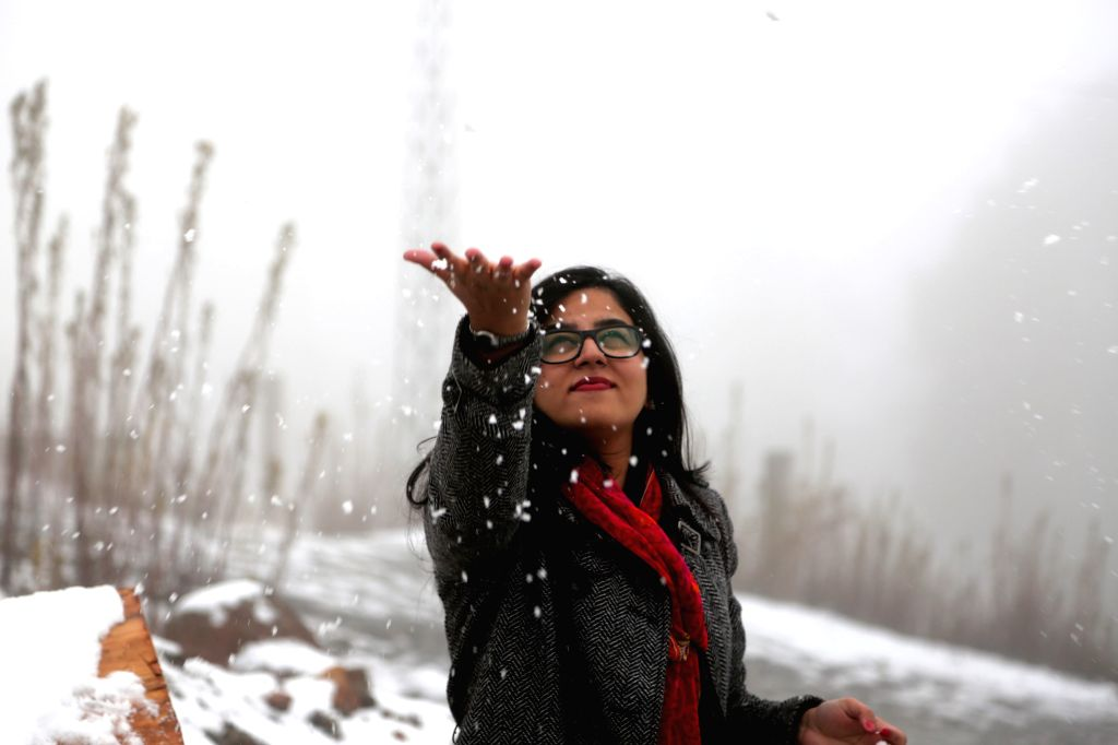 MURREE, Jan. 14, 2017 - A woman plays with snow during a snowfall in Murree, Pakistan, Jan. 14, 2017.