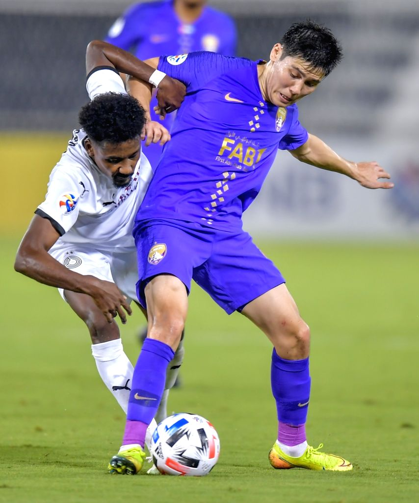Musab Al Khader (L) of Al Sadd vies for the ball with Bauyrzhan Islamkhan of Al Ain FC during the AFC Asian Champions League group D football match between Al Sadd SC ...