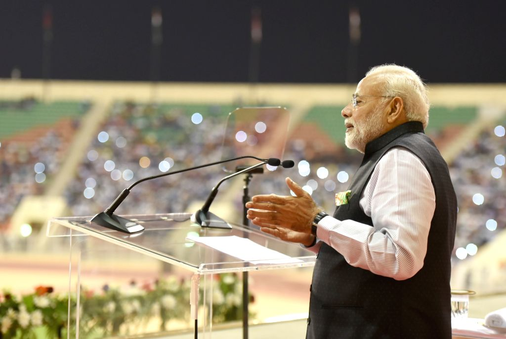 Muscat (Oman): Prime Minister Narendra Modi addresses the Indian community, at Sultan Qaboos Sports Complex, in Muscat, Oman on Feb 11, 2018. - Narendra Modi
