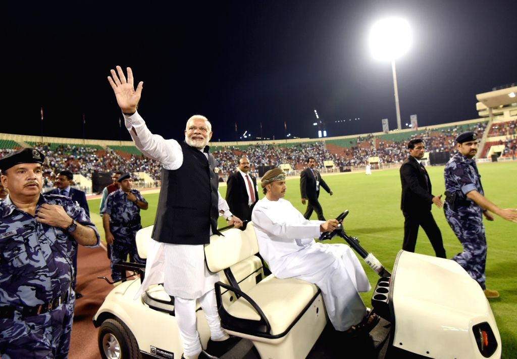 Muscat (Oman): Prime Minister Narendra Modi during the community event, at Sultan Qaboos Sports Complex, in Muscat, Oman on Feb 11, 2018. - Narendra Modi