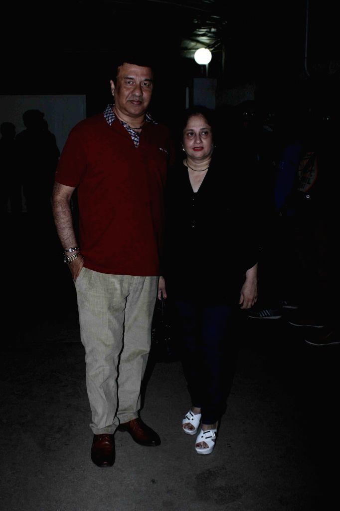 Music composer Anu Malik with his wife Anju Malik during the screening of film Jaanisaar in Mumbai, on August 6, 2015. - Malik