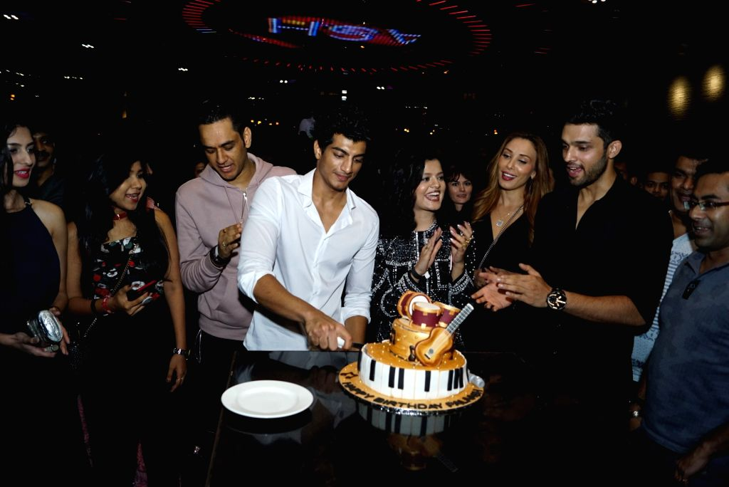 Music composer Palash Muchhal with Romanian TV presenter Iulia Vantur and singer Palak Muchhal during his birthday celebration in Mumbai on May 22, 2018.