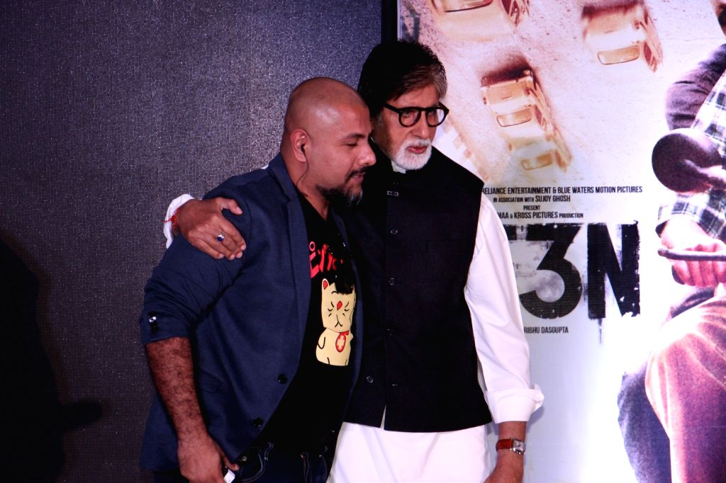 Music composer Vishal Dadlani with actor Amitabh Bachchan during the music launch of film Te3n in Mumbai on May 27, 2016. - Amitabh Bachchan