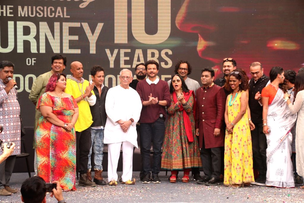 """Music Director A.R. Rahman with lyricist Gulzar and singer Ila Arun during the 10-year celebration of the music of """"Slumdog Millionaire"""" that won eight awards at the Oscars, in ..."""