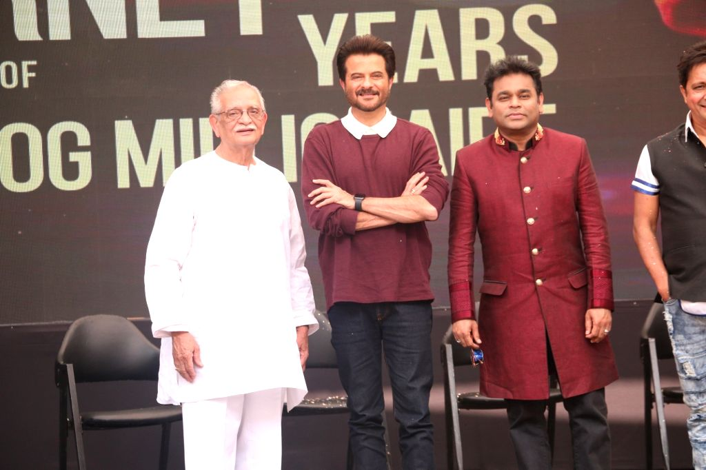 """Music Director A.R. Rahman with lyricist Gulzar, actor Anil Kapoor, singers Sukhwinder Singh and Ila Arun during the 10-year celebration of the music of """"Slumdog Millionaire"""" that ... - Anil Kapoor and Sukhwinder Singh"""