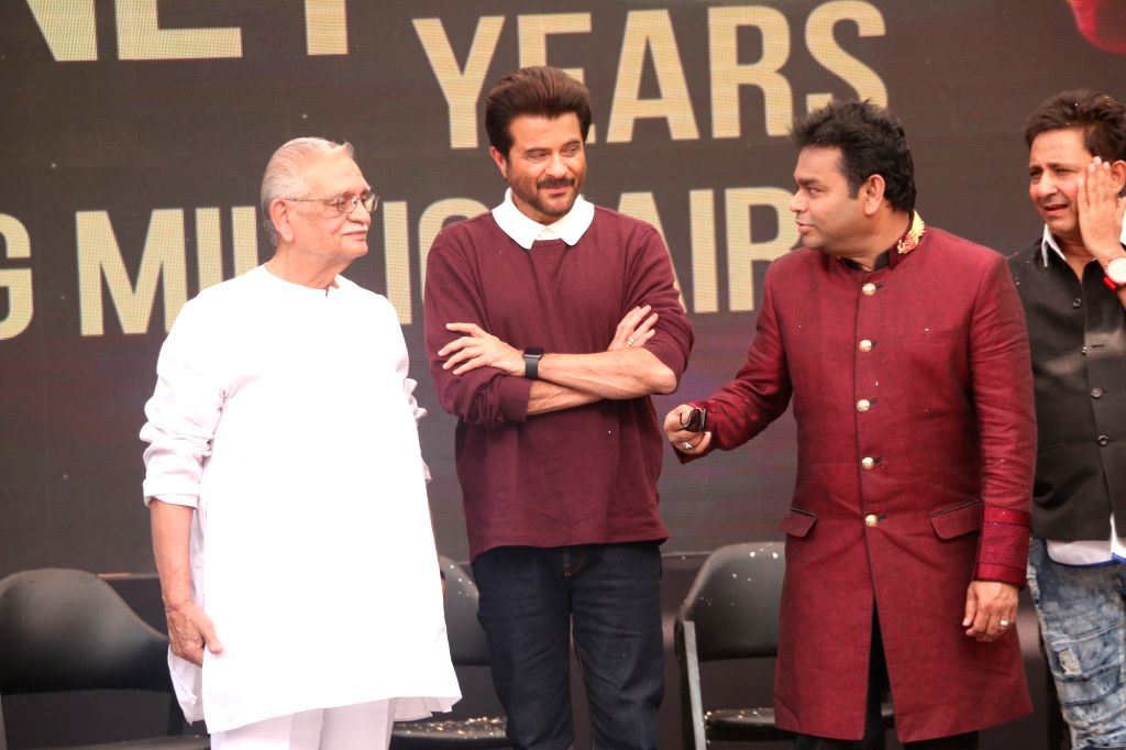"""Music Director A.R. Rahman with lyricist Gulzar and actor Anil Kapoor during the 10-year celebration of the music of """"Slumdog Millionaire"""" that won eight awards at the Oscars, in ... - Anil Kapoor"""