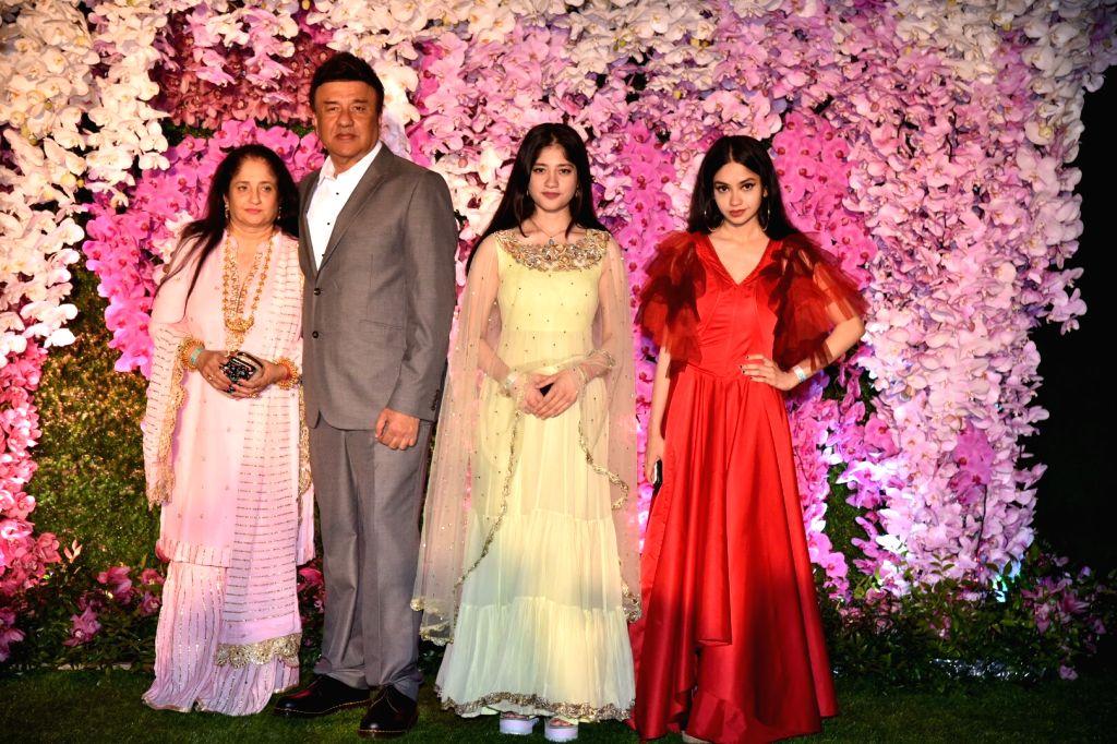 Music director Anu Malik along with his wife Anju Anu Malik at the wedding reception of Akash Ambani and Shloka Mehta in Mumbai on March 10, 2019. - Anu Malik, Akash Ambani and Shloka Mehta