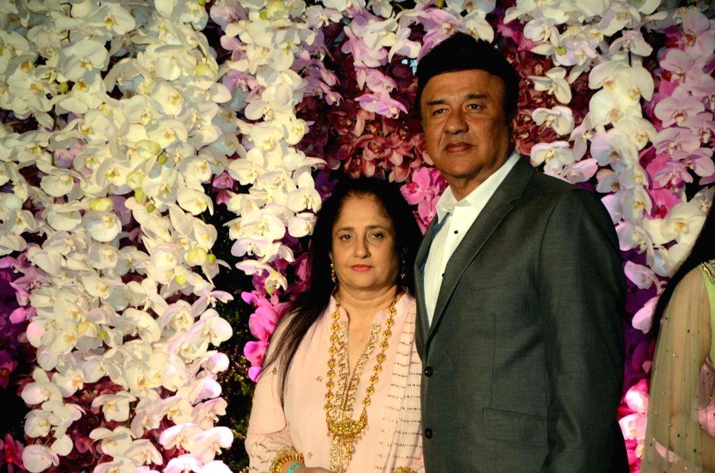 Music director Anu Malik with his wife Anju Anu Malik at the wedding reception of Akash Ambani and Shloka Mehta in Mumbai, on March 10, 2019. - Anu Malik, Akash Ambani and Shloka Mehta