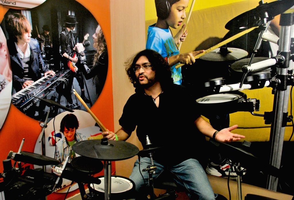 Musician Rupam Islam perform during launch of India`s first Roland School of Music Japan in Kolkata on March 21, 2013.