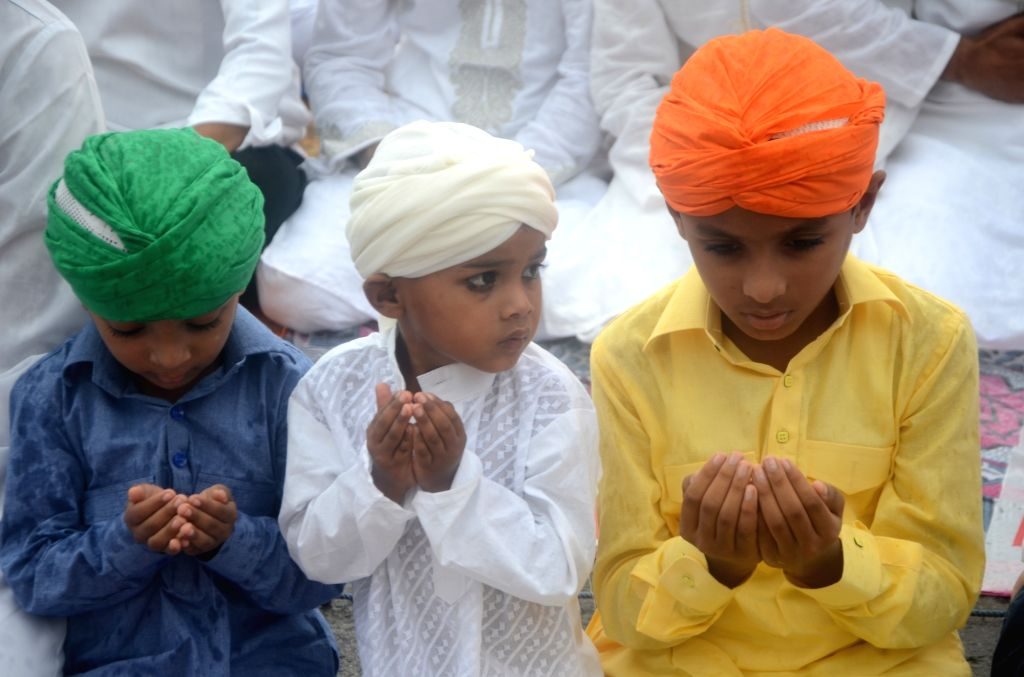 Muslim children dressed in colourful clothes offer prayer on the occasion of Eid-ul-Fitr in Mumbai on June 26, 2017.