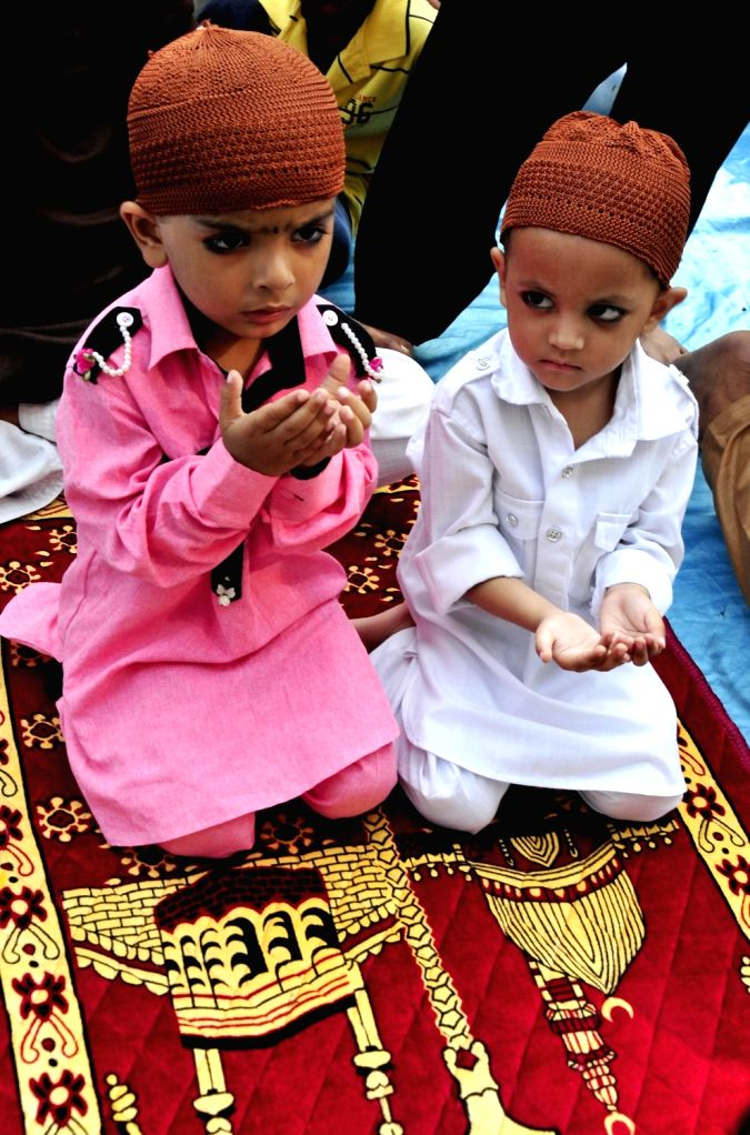Muslim children greet after prayers on the occasion of Eid-ul-Fitr at Khairudeen Jama Masjid in Amritsar on June 26, 2017.