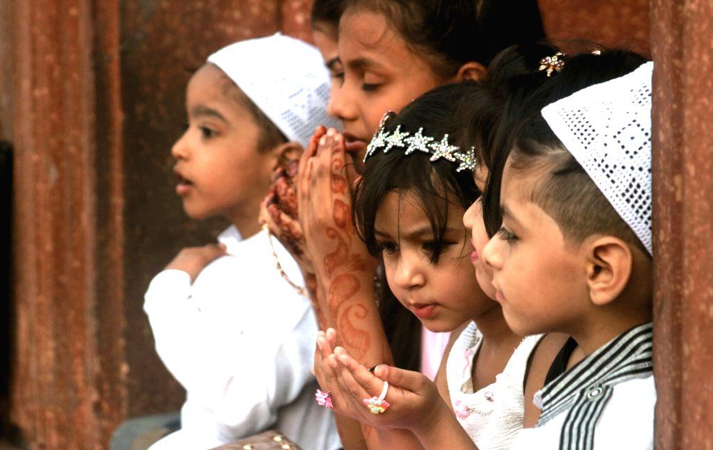 Muslim children offering prayer on the occasion of Eid-ul-Fitr at Jama  Masjid in New Delhi on June 26, 2017.