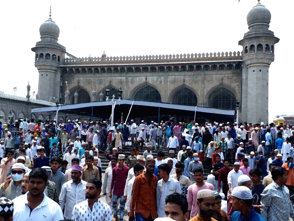 Muslim devotees arrive to offer Friday prayers at Mecca Masjid amid COVID-19 (coronavirus) pandemic, in Hyderabad on March 20, 2020.