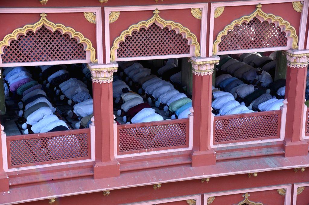 Muslim devotees offer Eid prayers on the Eid-al-Fitr festival at Nakhoda Masjid in Kolkata on 14 May, 2021.