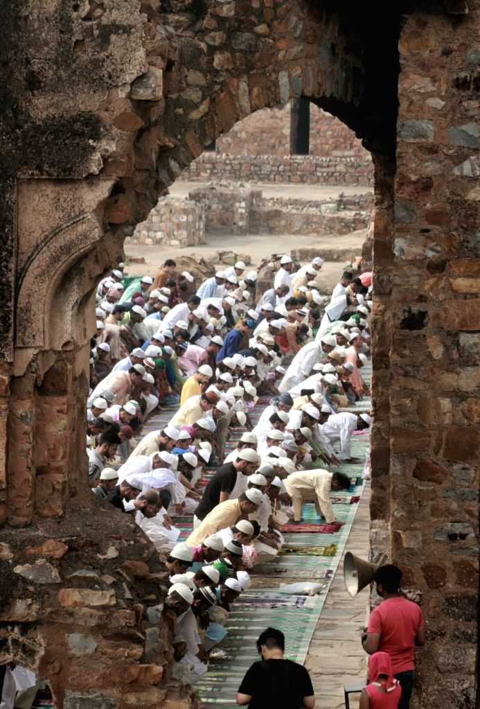 Muslim devotees offer prayer on the occasion of Eid-ul-Fitr at Feroz Shah Kotla ground in New Delhi on June 26, 2017. - Feroz Shah Kotla