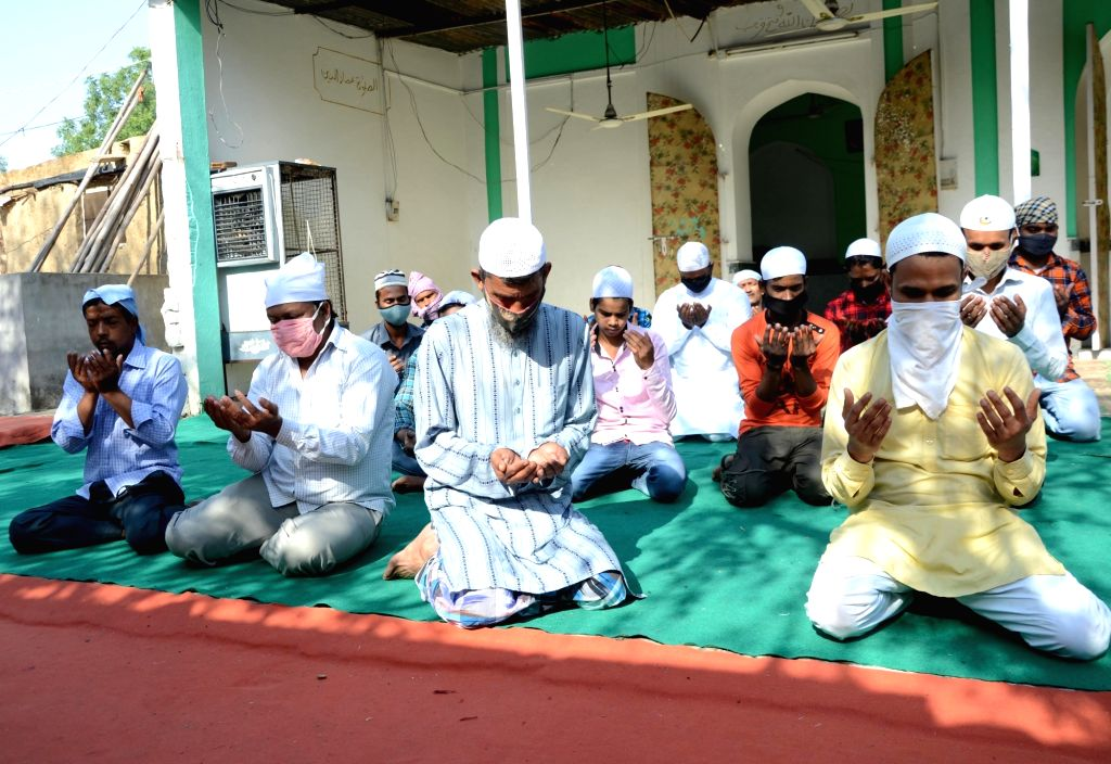 Muslim devotees  offer prayers on the occasion of Eid-al-Fitr, marking the end of holy fasting month of Ramadan,  in Amritsar, Friday, 14 May 2021.