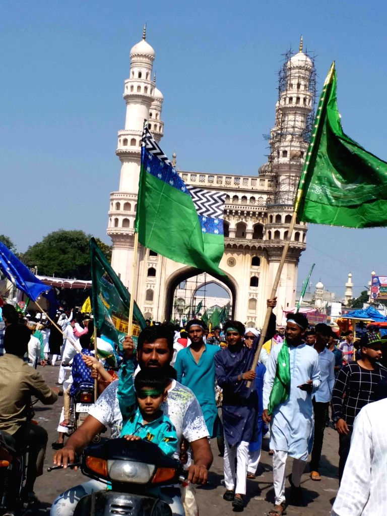Muslim devotees participate in a religious procession on the occasion of Eid Milad-un-Nabi, the birth anniversary of Prophet Muhammad - the founder of Islam, in Hyderabad on Nov 10, 2019.