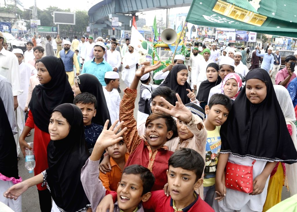 Muslim devotees participate in a religious procession on the occasion of Eid Milad-un-Nabi, the birth anniversary of Prophet Muhammad - the founder of Islam, in Kolkata on Nov 10, 2019.