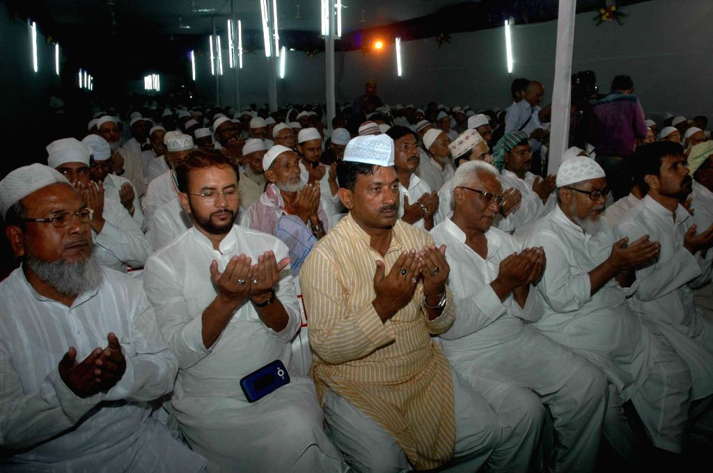 Muslim Haj pilgrims offer prayers during a programme organised to sees-off the first batch of Haj pilgrims from Patna on Aug 17, 2015.