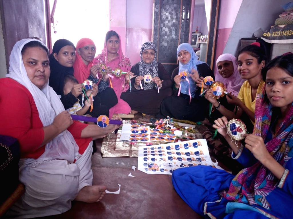 Muslim women busy making rakhis with picture of Prime Minister Narendra Modi. - Narendra Modi