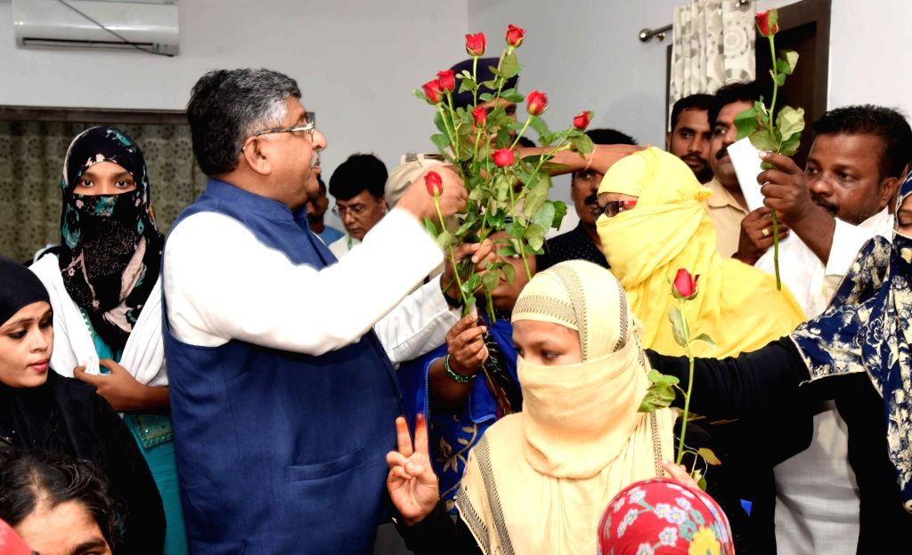 Muslim women celebrate at the residence of Union Law and Justice, Communications and Electronics and Information Technology Minister Ravi Shankar Prasad after triple talaq bill by Parliament ... - Ravi Shankar Prasad