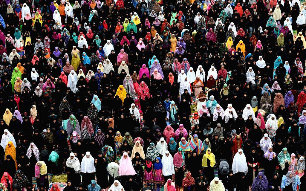 Muslim women offer prayers on Eid al-Fitr in Chennai, India, Tuesday, July 29, 2014. Millions of Muslims across the world are celebrating the Eid al-Fitr holiday, which marks the end of the ...