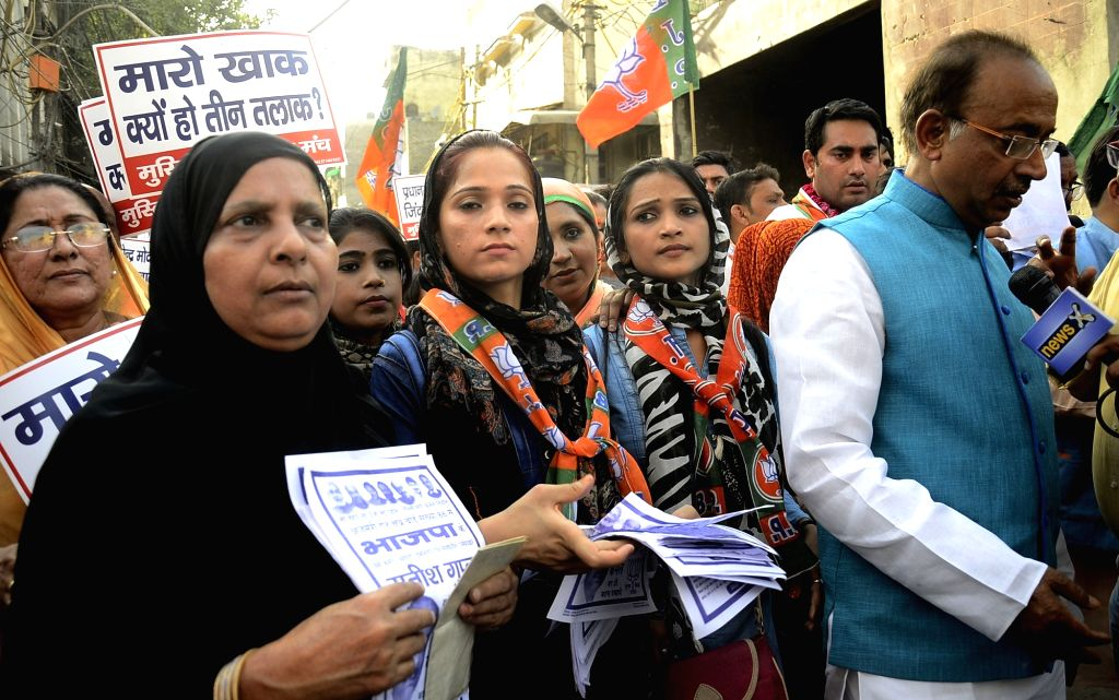 Muslim women participate in a BJP rally led by Union Minister and BJP leader Vijay Goel ahead of Delhi MCD Polls in New Delhi on April 20, 2017.
