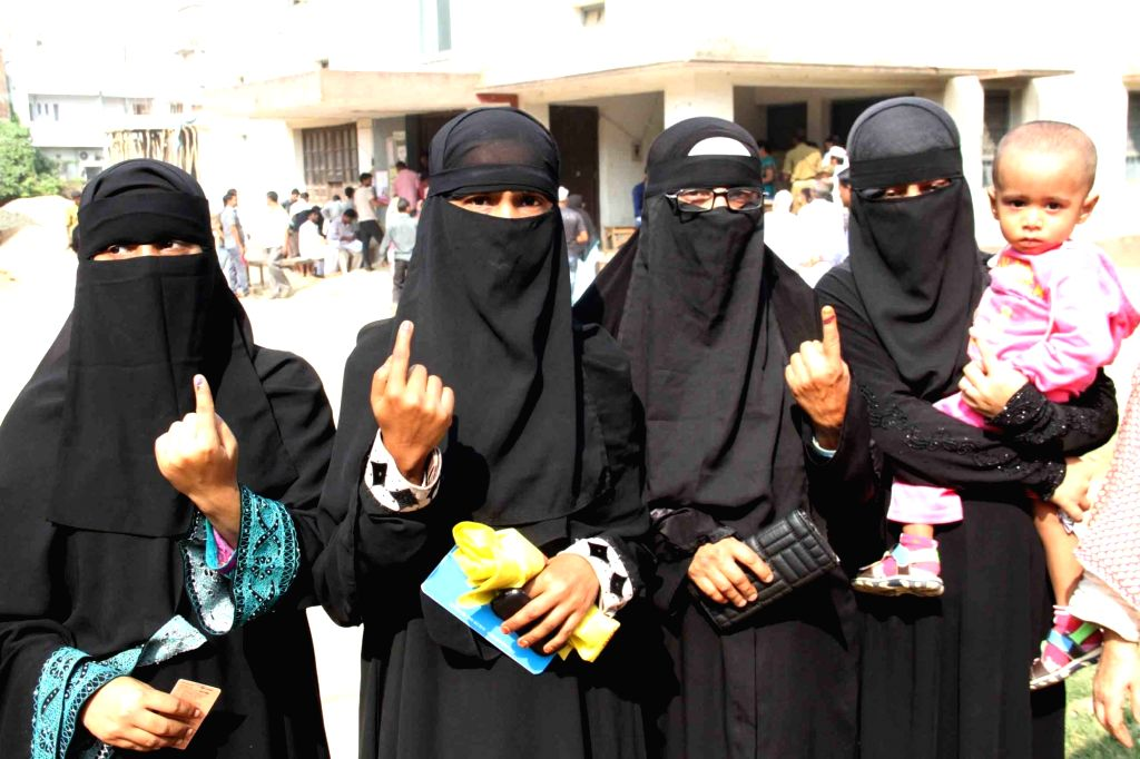 Muslim women showing their finger marked with phosphorous ink after casting their vote during the third phase of Bihar assembly polls in Patna on Oct 28, 2015.