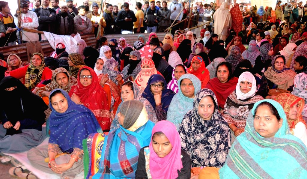Muslim women stage a sit-in demonstration against the Citizenship Amendment Act (CAA) 2019, National Population Register (NPR) and the National Register of Citizens (NRC) at Shaheen Bagh ...