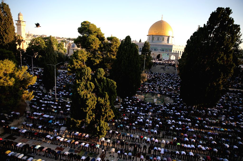 Muslim worshippers pray as they mark Eid al-Adha on the compound known to Muslims as Noble Sanctuary and to Jews as Temple Mount in Jerusalem's Old City, on July ...