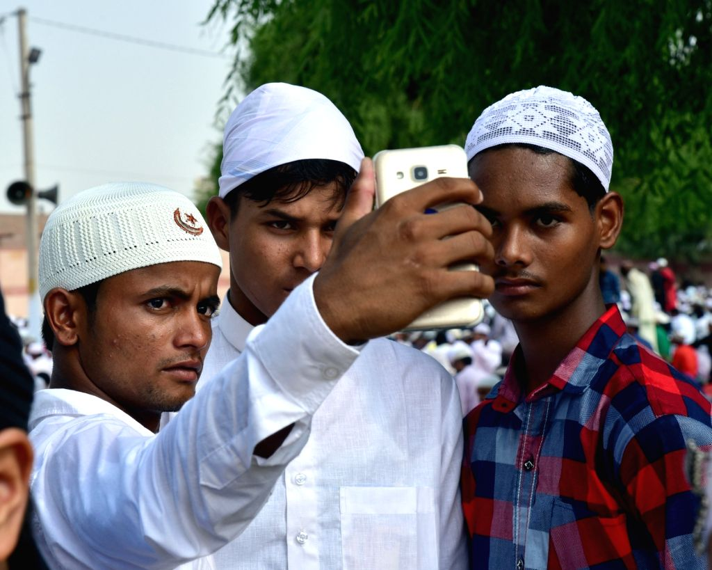 Muslim youths take a selfie after prayers on the occasion of Eid-ul-Fitr in Bikaner, Rajasthan on June 26, 2017.