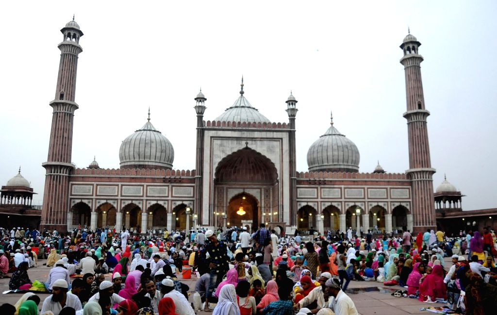 Muslims break their fast during holy month of Ramadan at Jama Masjid in New Delhi on June 23, 2016.