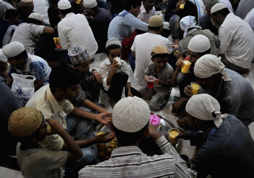 Muslims break their fast during Ramadan at Iqbal Maidan in Mumbai on May 29, 2017.