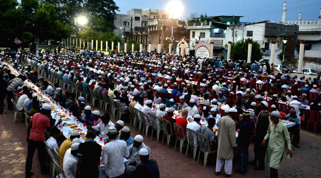 Muslims break their fast during Ramadan in Bhopal's Iqbal Maidan on June 15, 2017.