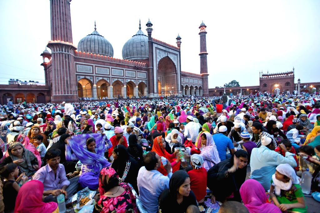 Muslims break their fast in front of Jama Masjid in New Delhi on July 27, 2014.