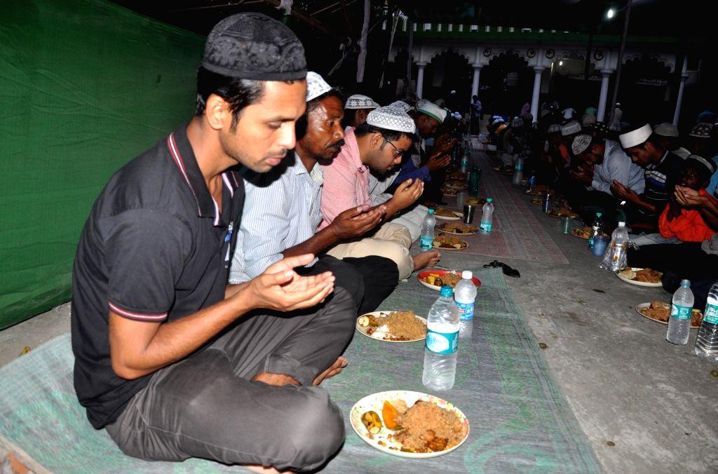 Muslims break their fast on the first day of Ramadan in Guwahati on May 28, 2017.