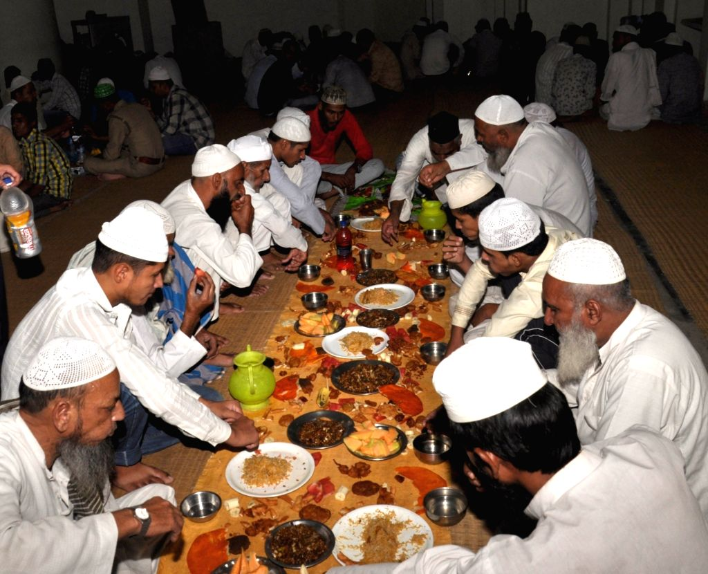 Muslims break their fast on the first day of Ramadan in Lucknow on May 28, 2017.