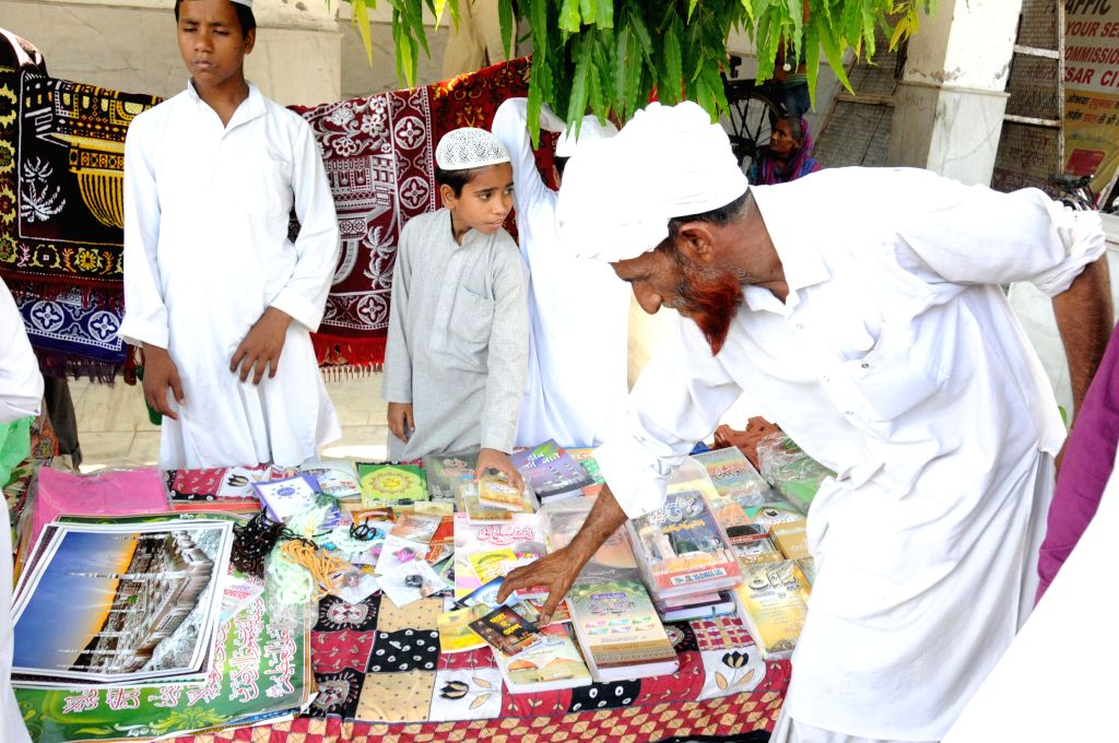 Muslims busy buying various items after offering friday namaz during the holy month of Ramadan at the Kherudin Jama Masjid in Amritsar on June 26, 2015.