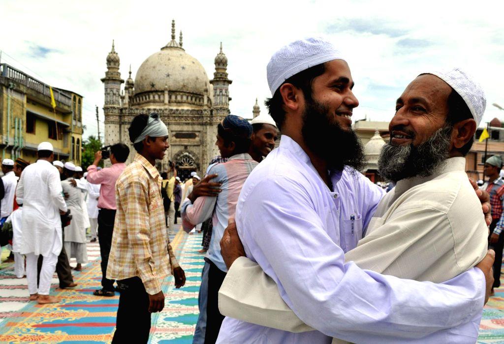 Muslims hug after Eid-ul-Fitr prayers in Tripura on July 29, 2014.